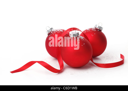 Red christmas ball with ribbon on white background. - Stock Photo