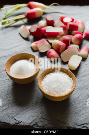 Fresh radishes with salt - Stock Photo
