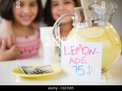 USA, New Jersey, Jersey City, Close up of two girl's selling lemonade - Stock Photo