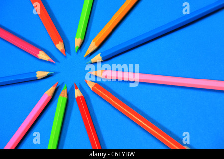 Multi-coloured pencils or crayons in a circle - Stock Photo