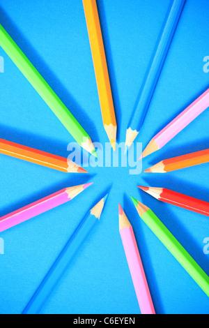 Pencil circle, colourful pencils on blue. - Stock Photo