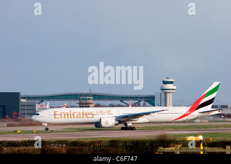 A6-EBW Emirates Boeing 777-31H/ER taxiing at London Gatwick - Stock Photo