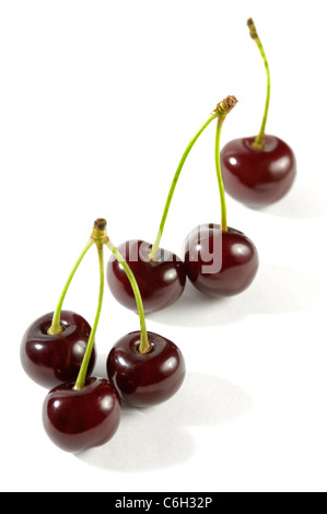One Two and Three cherries close-up Isolated over white background - Stock Photo