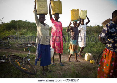 Girl Carrying A Water Jug On Her Head African Village
