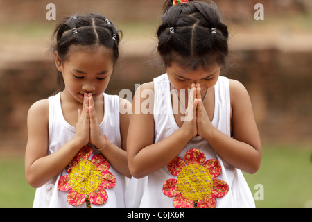 Thai little girls traditional greetings ayuthaya thailand stock thai little girls traditional greetings ayuthaya thailand stock photo m4hsunfo
