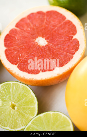 Grapefruit and lime halves - Stock Photo