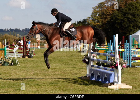 A competitor in the show jumping event at the Bucks County Show 2011. - Stock Photo