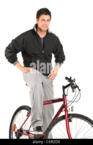 A young boy posing on a bike - Stock Photo