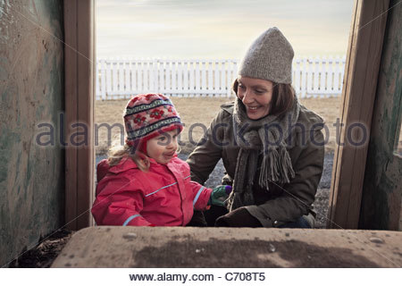 Mother and daughter playing outdoors - Stock Photo