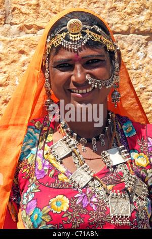 Portrait tribal woman wearing tribal jewellery Jaisalmer Western Rajasthan India - Stock Photo