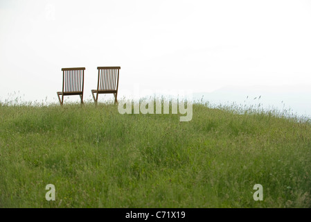 Empty chairs on meadow - Stock Photo