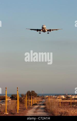 Air Malta Airbus A319 passenger jet plane on final approach - Stock Photo