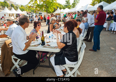 Paris, France, French Food and Wine Festival, St. Pourcinois, French Family Picnicking on Seine Quay - Stock Photo