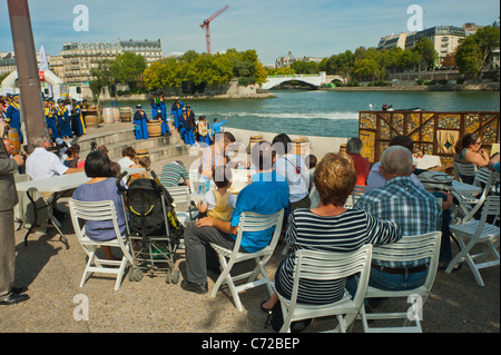 Paris, France, French Food and Wine Festival, St. Pourcinois, French Families Picnicking on Seine River Quay - Stock Photo