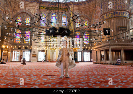 Young Turkish boy in their ceremonial circumcision outfit at The Blue Mosque in Turkey - Stock Photo