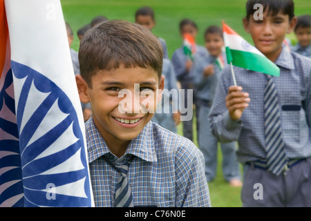 Portrait of a school boy with the Indian flag - Stock Photo