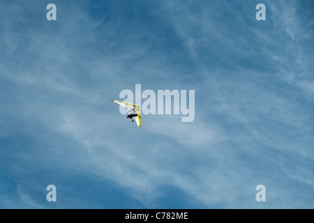 Hand-glider in the blue sky of Carolles (Normandy, France). - Stock Photo
