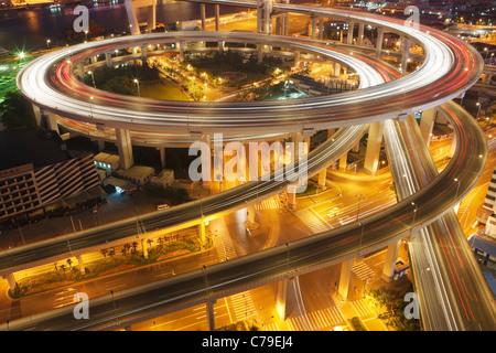 Traffic on roundabout leading to Nanpu bridge at dusk; Dongjiadu: Shanghai; China - Stock Photo