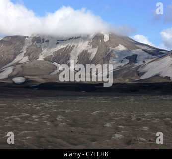 Mountain scenery near the mt. Hekla, lava and snow covered in volcanic ash - - Stock Photo