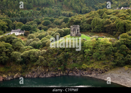 Llanberis, North Wales, UK. Aerial view of 13th century Dolbadarn Castle in woodland beside Llyn Peris lake in Snowdonia - Stock Photo
