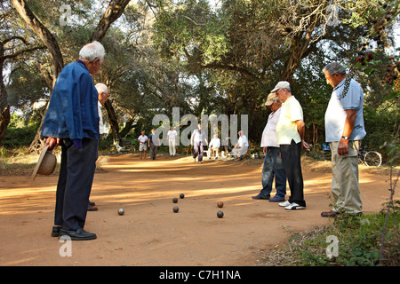 A group of old gentlemen playing a traditional game with metallic  balls called 'Abali', Preveza town, Epirus, Greece - Stock Photo