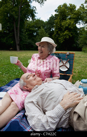 Senior couple have relaxing picnic in the park - Stock Photo