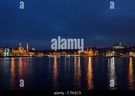 Night view of the Golden Horn from the Galata bridge and the Yeni Camii ('New Mosque') to Suleymaniye mosque. Istanbul, - Stock Photo