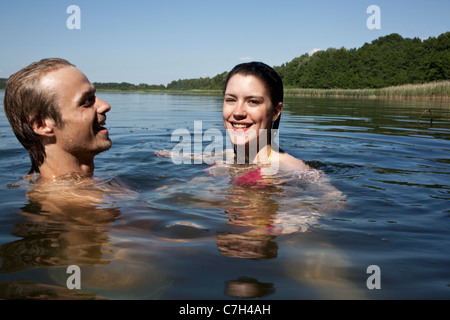 Beautiful Young Woman Swimming Up To The Surface With