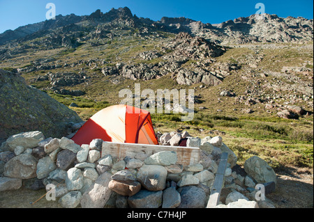 Tent surrounded by rocks on The Wetterstein, Tirol, Austria, - Stock Photo