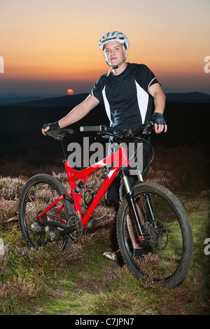 Smiling man with bicycle outdoors - Stock Photo