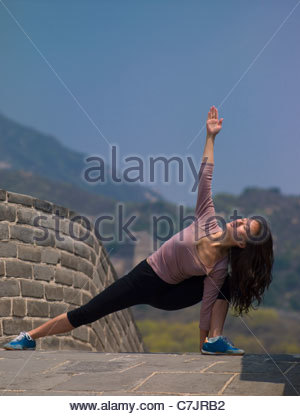 Woman posing on Great Wall of China - Stock Photo