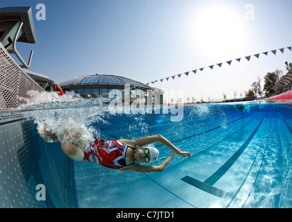 A female swimmer training in an open air Olympic swimming pool (France).Underwater view. - Stockfoto