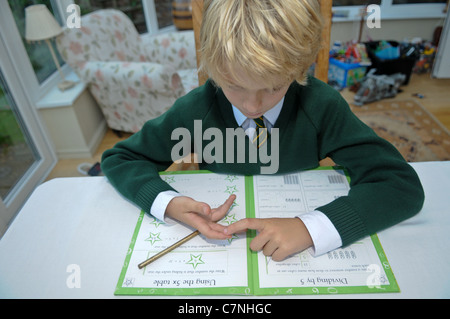 Year Old Boy Is Doing Homework At The Kitchen Table In A Modern     Vector illustration school boy kid sitting at the desk and doing his  homework  Flat concept