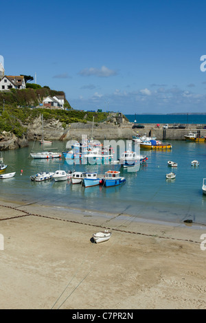 Colourful boats in Newquay and the harbour beach, Cornwall UK. - Stock Photo