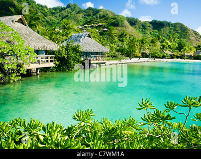 Over water bungalows and an amazing green lagoon - Stock Photo