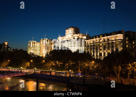 Adelphi Building, Shell Mex House and the Savoy Hotel with the River Thames at night, London, from Waterloo Bridge - Stock Photo