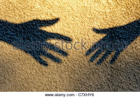 Shadow hands reaching out - Stockfoto