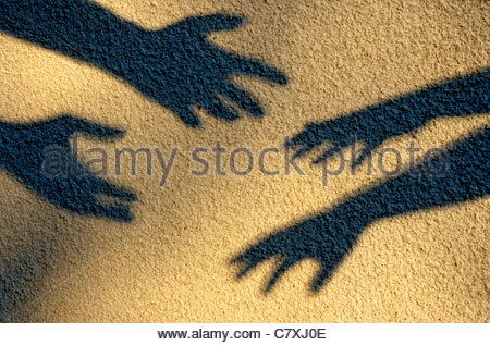 Four shadow hands reaching out - Stockfoto