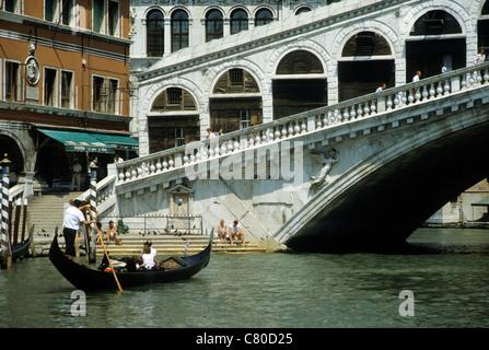 Italy, Venice, Rialto bridge on Canal Grande, gondola - Stock Photo