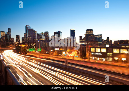 Seattle Downtown skyline with I-5 traffic with car light streaks - Stock Photo