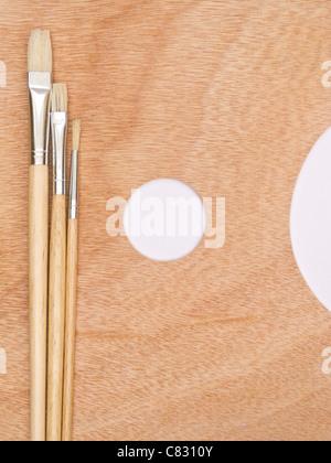 Paint brush on palette - Stock Photo