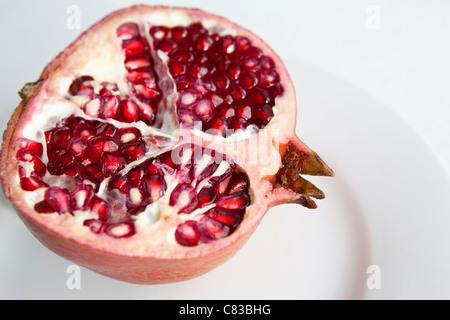 Close up of halved pomegranate - Stock Photo