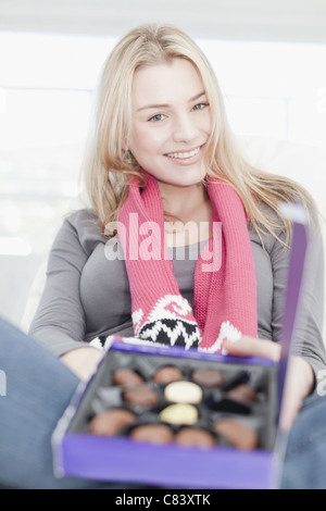 Teenage girl with box of chocolates - Stock Photo