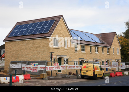 Southern Solar energy company installing solar panels on roofs of Lovell and Council new build affordable housing. - Stock Photo
