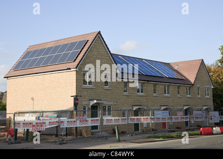 Bath, Somerset, England, UK, Britain. Solar panels being installed on the roofs of Lovell new build houses - Stock Photo