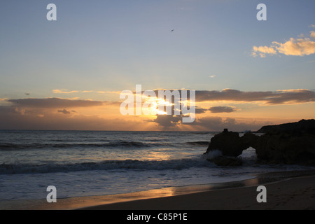 Sunset on a beach in Albuferia, Portugal - Stock Photo