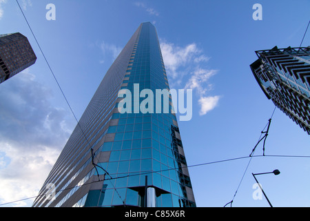 Looking up at a tall skyscraper on Broadway in Denver, CO, USA. - Stock Photo