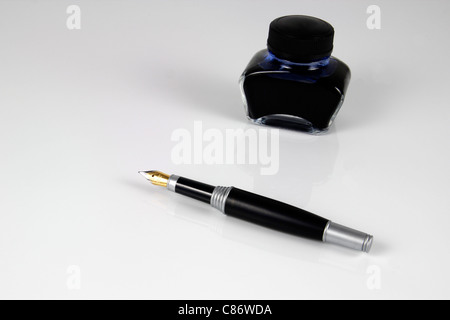 A ink bottle with a filler - Stock Photo