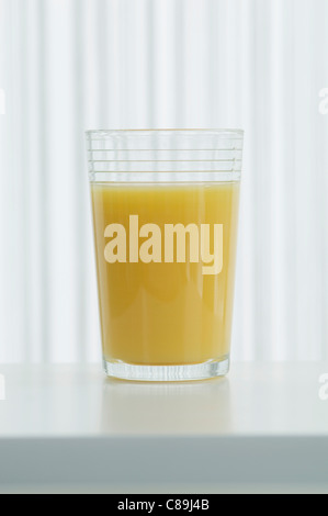 Glass of orange juice on table, close up - Stock Photo