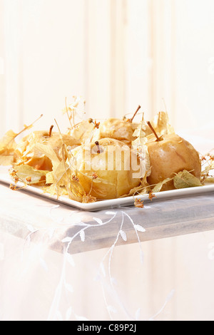 Canadian Reinette apples cooked in a casserole dish with lime blossom - Stock Photo